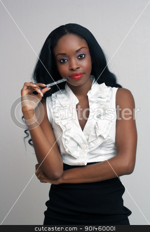 Beautiful Young Businesswoman (1) stock photo, An extraordinarily beautiful young businesswoman holding an ink pen. by Carl Stewart