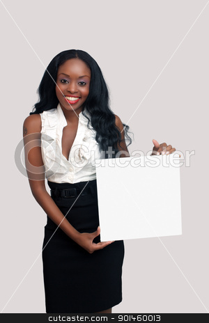 Beautiful Young Businesswoman Holding a Blank White Card (2) stock photo, An extraordinarily beautiful young businesswoman holding a blank white card.  Isolated on a light-grey background with generous copyspace. by Carl Stewart