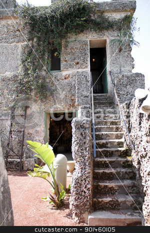 Inside the mysterious Coral Castle (16) stock photo, HOMESTEAD, FL - APRIL 2010: Stairs to the living quarters inside the mysterious Coral Castle in April, 2010.  The builder took his secrets with him to the grave. by Carl Stewart