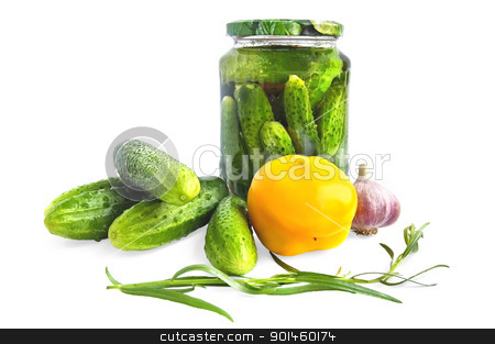 Preserving cucumber in glass jar stock photo, Cucumbers in a glass jar on the table, yellow bell pepper, garlic, tarragon sprig is isolated on a white background by rezkrr