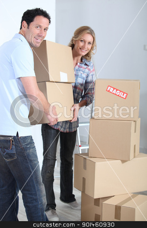 Couple stacking boxes stock photo, Couple stacking boxes by photography33