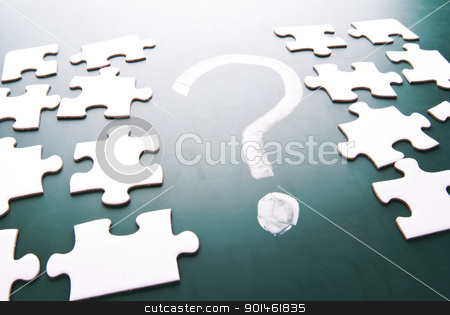 Question mark and puzzle pieces stock photo, Question mark and puzzle pieces on blackboard by Lawren