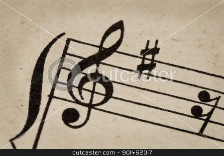 treble clef - music concept stock photo, treble clef - macro of sheet music on vintage paper by Marek Uliasz