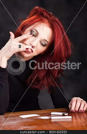 Woman and drugs stock photo, Young depressed woman taking narcotics by iMarin