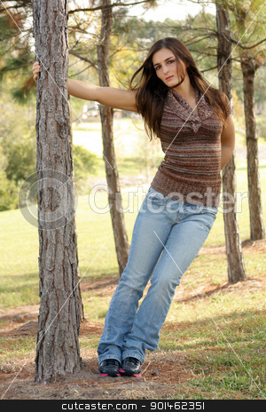 Lovely Young Brunette Outoors (1) stock photo, An attractive young brunette in casual wear outdoors. by Carl Stewart