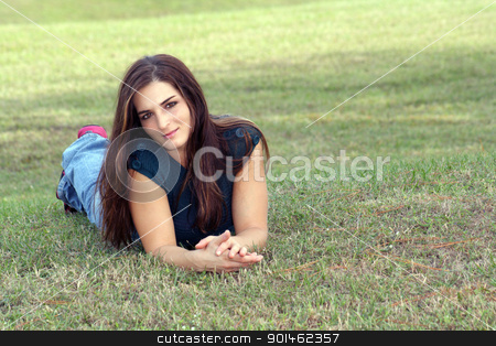 Lovely Young Brunette Outoors (7) stock photo, An attractive young brunette in casual wear relaxes outdoors, lying in the grass. by Carl Stewart