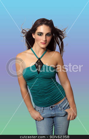 Lovely Young Brunette in Casual Wear (1) stock photo, A lovely young brunette in casual wear with her hair blowing, against a multi-colored pastel background. by Carl Stewart