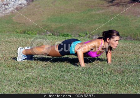 Beautiful Brunette Does Pushups Outdoors (4) stock photo, A lovely young athlete does pushups outdoors.  Generous copyspace. by Carl Stewart