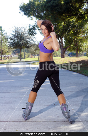 Beautiful Athletic Rollerblader Outdoors (4) stock photo, A lovely young brunette rollerblades away from the camera outdoors. by Carl Stewart