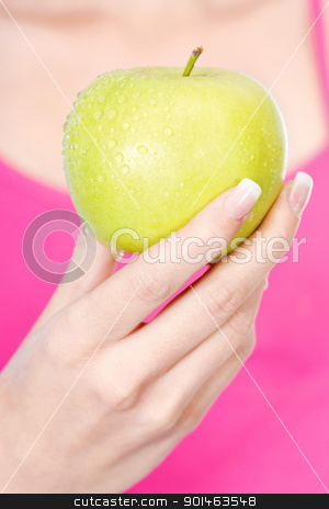 Fruit in woman's hand stock photo, woman's hand holding wet apple by iMarin