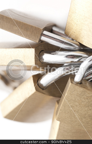 Bunch Of Brass Padlocks stock photo, Bunch Of Brass Padlocks, closeup abstract background on white by Stephen Gibson