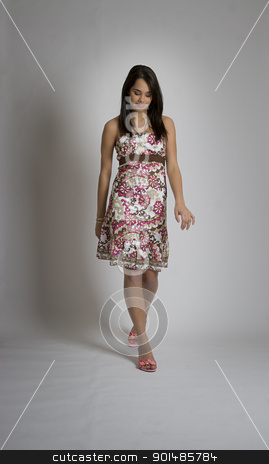 Walking up stock photo, Young woman looking down and walking towards the camera by Yann Poirier