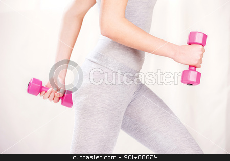 fitness exercises stock photo, Female body doing fitness exercises with two weights by iMarin