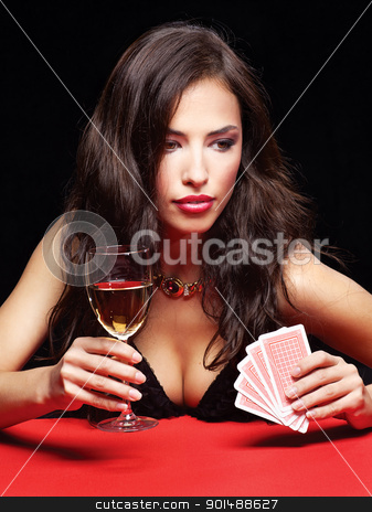 pretty woman gambling on red table stock photo, pretty young woman gambling on red table by iMarin