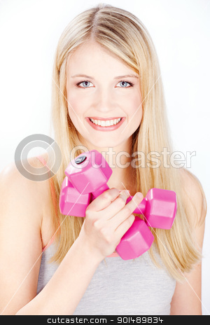 smiled woman holding two weights stock photo, Young smiled woman holding two weights in one hand by iMarin