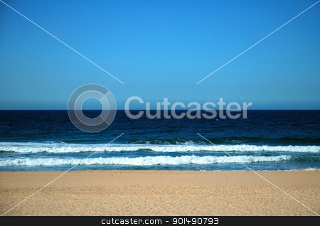 beach stock photo, sand, dark sea with waves reaching the beach, clear blue sky by Robert Remen