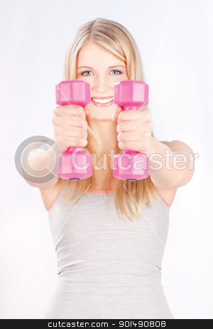 fitness exercises stock photo, Young woman with two weights doing fitness exercises by iMarin