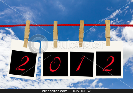 Photo frames 2012 and blue sky stock photo, Photo frames 2012 and blue sky hang by wooden peg on white background by stoonn