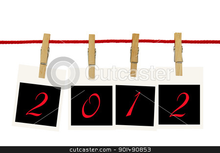 Photo frames 2012 stock photo, Photo frames 2012 hang by wooden peg on white background by stoonn
