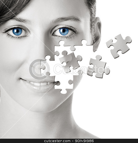 Puzzle Face stock photo, Healh concept image - Beautiful young woman with puzzle pieces by ikostudio