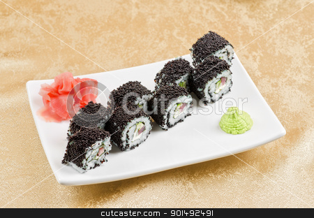tuna sushi roll stock photo, sushi roll with tuna, avacado, sauce and flying fish roe by olinchuk