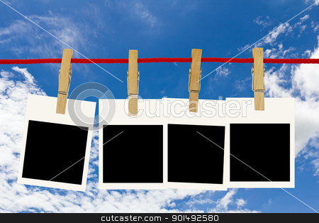 Blank photo frames  stock photo, Blank photo frames hang by wooden peg on blue sky by stoonn