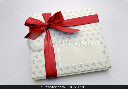 Printed over a red ribbon gift box stock photo, Printed over a red ribbon gift box by Turhan Yalçın
