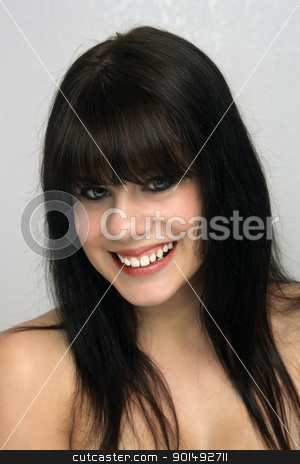Beautiful Young Brunette, Headshot (1) stock photo, A studio close-up of a lovely young brunette with a captivating smile. by Carl Stewart