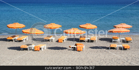 Greece. Kos island. Kefalos beach stock photo, Greece. Kos island. Kefalos beach. Orange chairs and umbrellas on the beach  by Morozova Oxana