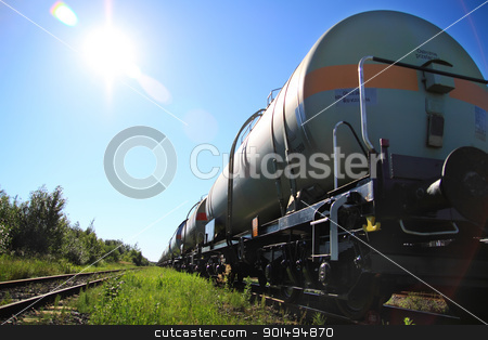Oil and fuel transportation by rail stock photo, Tanks with fuel being transported by rail, taken in backlit by Deekens