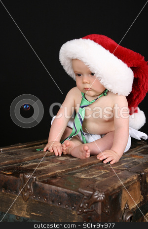 Christmas baby stock photo, Cute christmas baby boy sitting on an antique trunk by Vanessa Van Rensburg