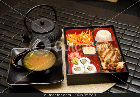 Sushi lunch stock photo, Sushi lunch with soup salad tea and sauce by olinchuk