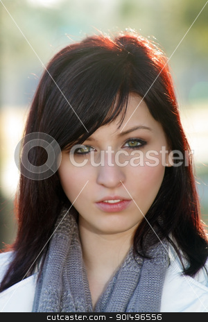 Beautiful Woman Outdoors (3) stock photo, Close-up of a beautiful young woman with auburn hair, outdoors, backlit with brilliant morning sunlight. by Carl Stewart