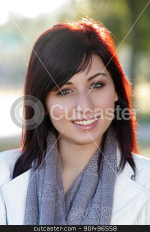 Beautiful Woman Outdoors (5) stock photo, Close-up of a beautiful young woman with auburn hair, outdoors, backlit with brilliant morning sunlight. by Carl Stewart