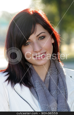 Beautiful Woman Outdoors (6) stock photo, Close-up of a beautiful young woman with auburn hair, outdoors, backlit with brilliant morning sunlight. by Carl Stewart