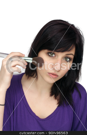 Beautiful Young Woman Applies Makeup (2) stock photo, A studio close-up of a lovely young woman with remarkable eyes, applying makeup with a brush. by Carl Stewart