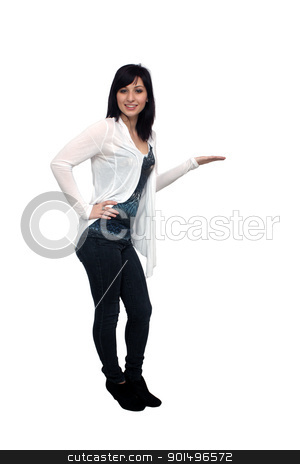 Beautiful Young Casual Hostess (2) stock photo, A full-length shot of a lovely young woman, isolated on white, with her hand extended, palm up.  Generous copyspace. by Carl Stewart
