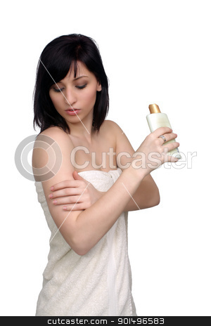 Beautiful Young Woman Wearing a Bath Towel (5) stock photo, A studio close-up of a lovely young woman wrapped in a white bath towel, rubbing lotion on her arm, isolated on a white background. by Carl Stewart