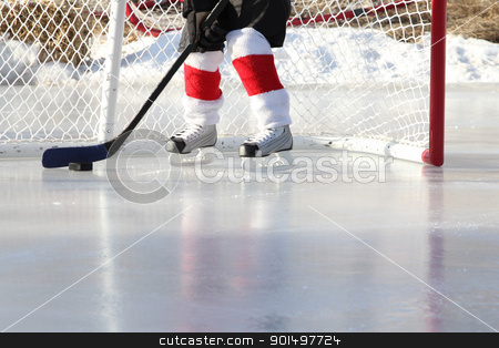 Pond Hockey stock photo, Young child playing outdoor pond ice hockey  by Vanessa Van Rensburg