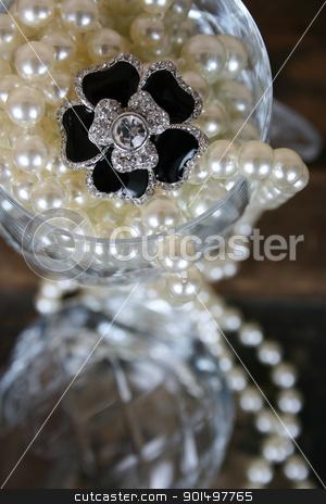 Flower Diamond stock photo, Black flower diamond ring amongst pearls in crystal glass by Vanessa Van Rensburg