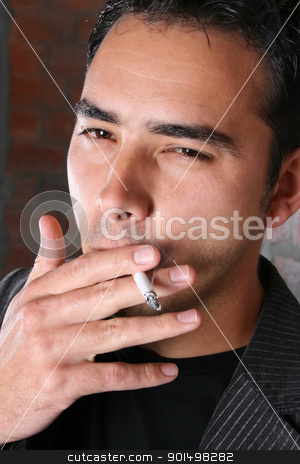 Smoking Male stock photo, Male model against rough brick wall background smoking a sigarette by Vanessa Van Rensburg