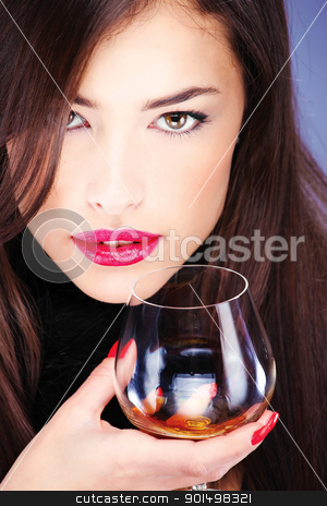woman with pelt, holding glass of brandy stock photo, Close up of a woman with pelt, holding glass of brandy by iMarin