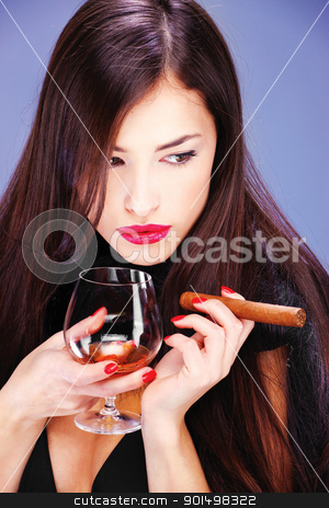 woman and cigar stock photo, Portrait of a pretty woman with pelt, holding glass of brandy and cigar by iMarin
