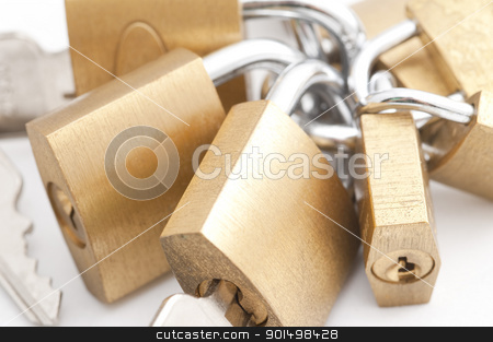 Bunch of padlocks stock photo, A high key image of some brass padlocks by Stephen Gibson