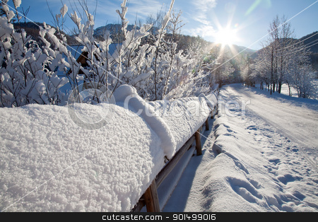 winter landscape on the outskirts of the city stock photo, the sun setting over the road in a winter landscape by marekusz