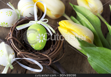 easter eggs with yellow tulip flowers stock photo, easter eggs with yellow tulip flowers  isolated on wooden board by klenova