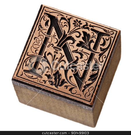 letter N prinitng block stock photo, ornamental initial letter N - copper and wood vintage letterpress printing block by Marek Uliasz