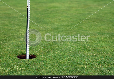 golf field detail stock photo, golf hole with white post, playing field by Robert Remen