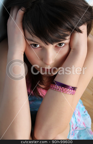Serious Teen stock photo, Beautiful brunette teen with a serious facial expression by Vanessa Van Rensburg