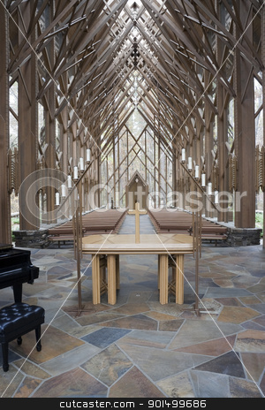 Church Alter stock photo, The insides of a wooden and glass church with alter by Kevin Tietz